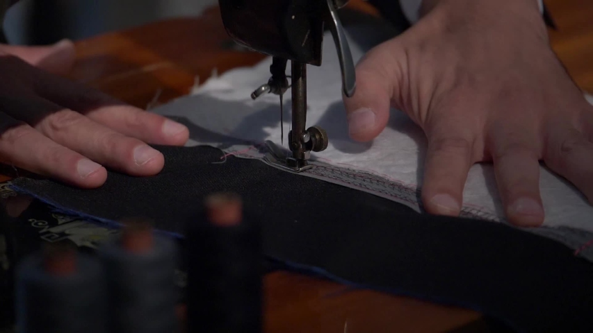 Slow motion footage at the tailors store, the tailor is preparing the final stitch on a cloth... | Shutterstock HD Video #1037838803
