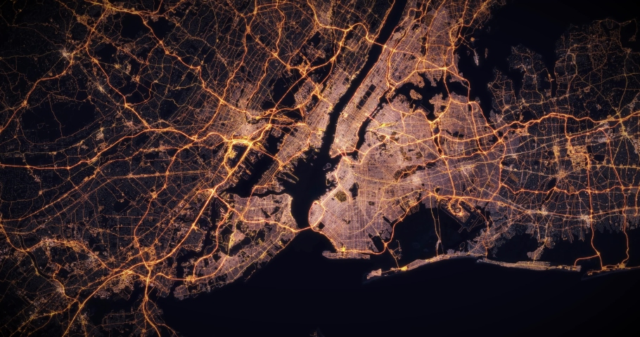 Aerial night view of city of New York, USA. Traffic and street light glowing. Camera flying high above, moving closer and rotating from space filming cinematic straight down. 3d animation rendering.
