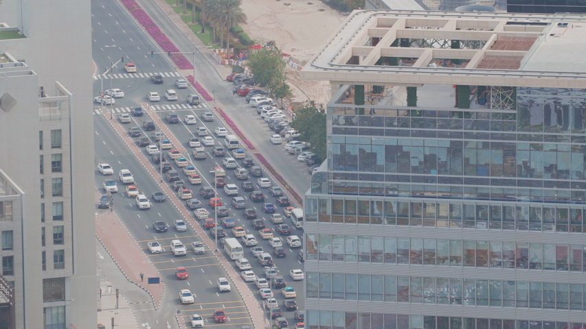 Skyline view of intersection traffic on Al Saada street near DIFC in Dubai, UAE. Skyscrapers in financial centre aerial view from above in downtown | Shutterstock HD Video #1038431153