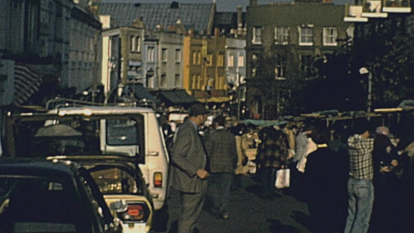 London - 1977: traffic and pedestrians in the street | Shutterstock HD Video #1038505343