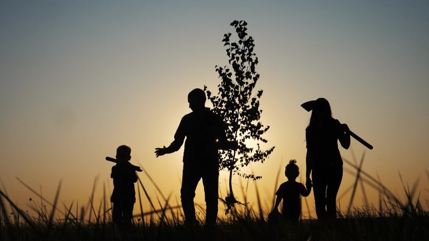 Happy family walking agriculture of farmers a silhouette concept slow motion video. mom dad son and daughter walk go children plant and water the tree outdoors lifestyle in the park. happy family | Shutterstock HD Video #1038852653