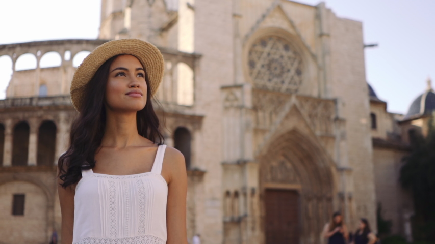 Young fashion girl exploring old city of Valencia in the morning at a sunny day | Shutterstock HD Video #1039016753