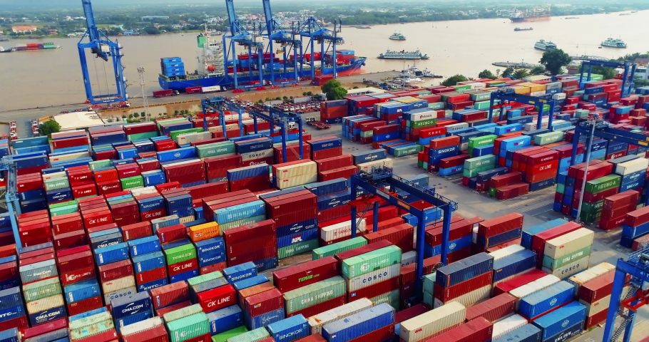 HCMC, Vietnam - September 28, 2019: Aerial flyover of cargo port in Southern Vietnam. Shipping in this area is fundamental to Vietnam's continued success within international trade. | Shutterstock HD Video #1039068713