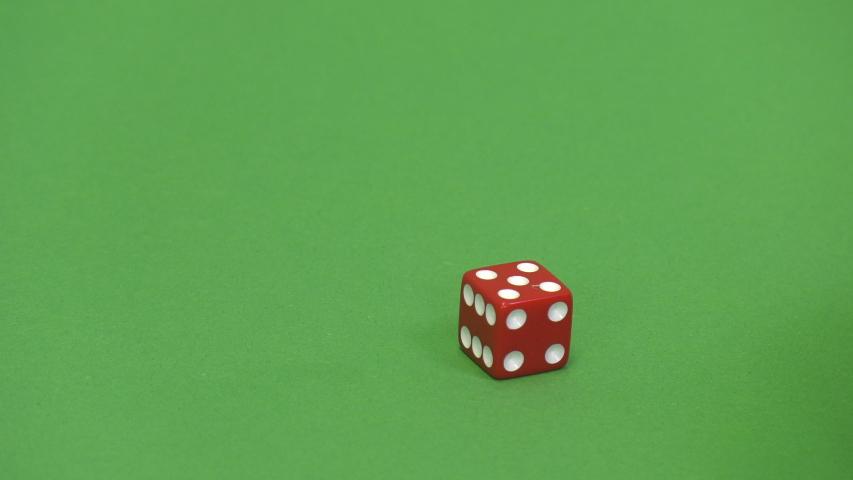 Green screen shot of a red dice rolling 5 | Shutterstock HD Video #1039102043