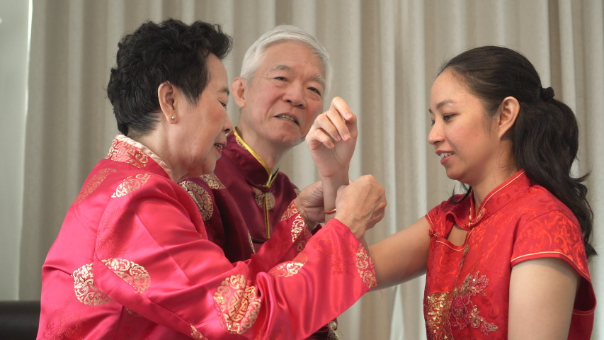 Asian parents give daughter in law thumb up Chinese New Year | Shutterstock HD Video #1039107593