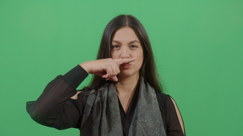 Woman Making Mustache With The Finger. Studio Isolated Shot Against Green Screen Background | Shutterstock HD Video #1039150943