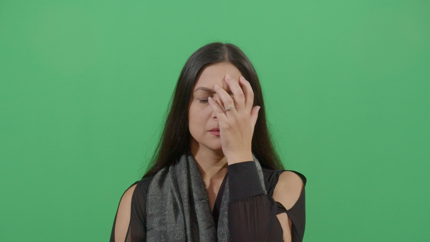 Frustration Demonstrated By An Woman. Studio Isolated Shot Against Green Screen Background | Shutterstock HD Video #1039151003