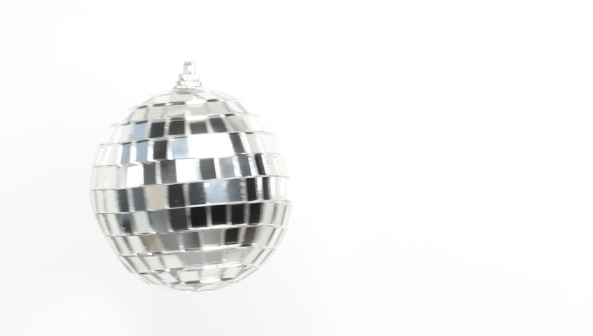 Disco Mirror Ball Spinning on white background | Shutterstock HD Video #1039591553