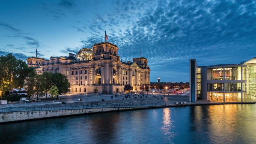 BERLIN, GERMANY - OCTOBER 20, 2019: Timelapse view of famous Reichstag building (german government) at evening, Berlin, Germany.