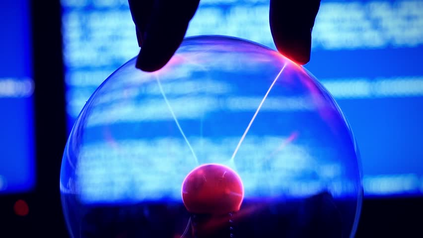 Plasma Ball - a transparent sphere filled with rarefied inert gas. Slowmotion of Hand touch the plasma ball against a blue background broken computer