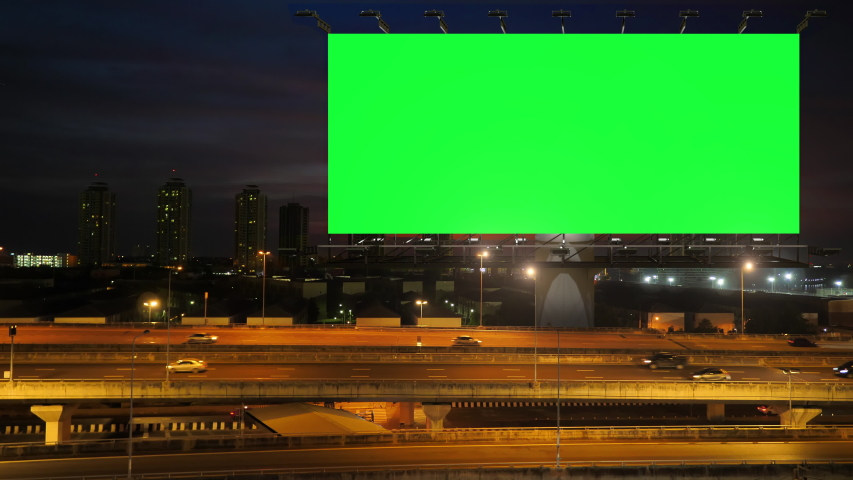 Green screen of advertising billboard on expressway during the twilight with city background in Bangkok, Thailand. | Shutterstock HD Video #1039953743