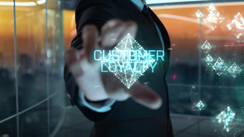 Businessman with Customer Loyalty hologram concept | Shutterstock HD Video #1040024003