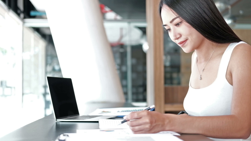 Businesswoman working with business document at office. Startup woman entrepreneur student studying writing note at workplace. | Shutterstock HD Video #1040190713