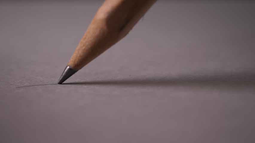 Hand drawing a flat line with a black pencil | Shutterstock HD Video #1040257433