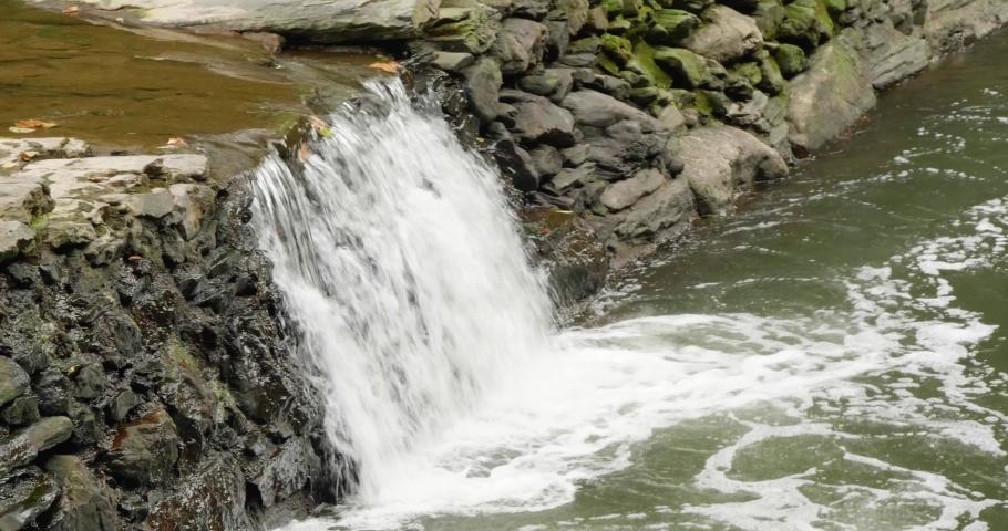 Waterfall near Covered Bridge, Thomas Mill at the Wissahickon Creek | Shutterstock HD Video #1040288183