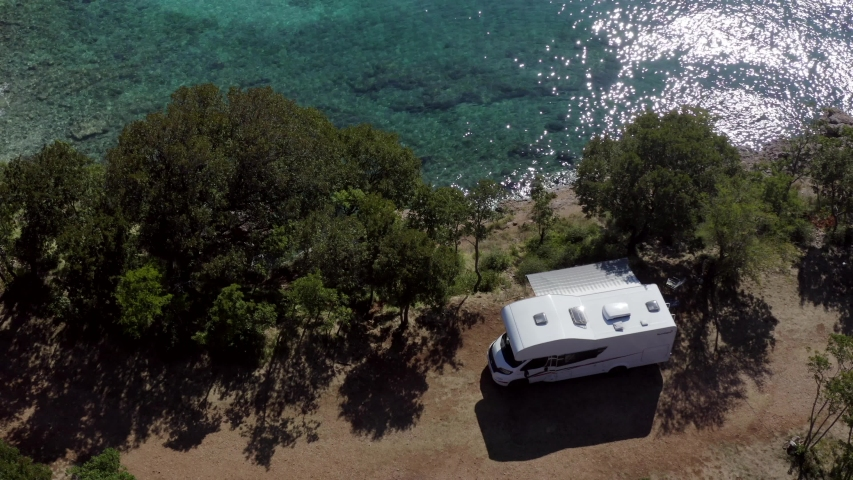 Aerial Footage of Scenic Sea. Modern Motorhome Van on the Mediterranean Sea Croatian Coast. Vacation on the Road. Turquoise Bay. | Shutterstock HD Video #1040290313