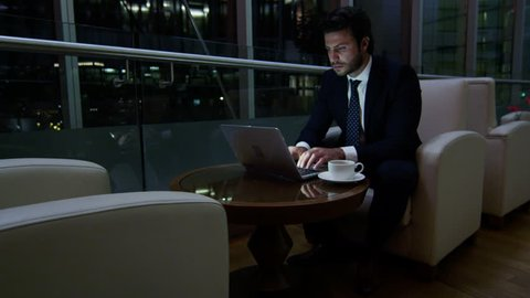 Caucasian European business male night developer traveller technology laptop