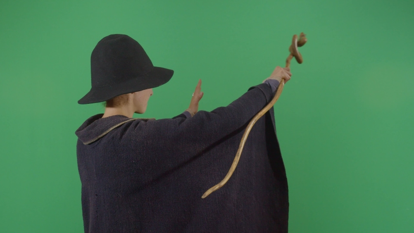 Woman Magician Opening A Portal On The Green Screen. Studio Isolated Shot Against Green Screen Background | Shutterstock HD Video #1040503043