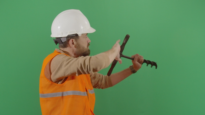 Adult Man Engineer Drilling The Green Screen. Studio Isolated Shot Against Green Screen Background | Shutterstock HD Video #1040503403