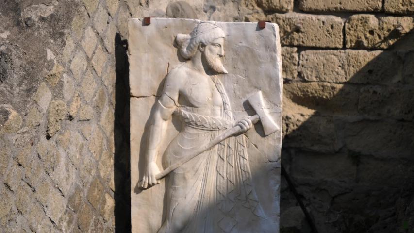 Ebros Vulcan Ancient Roman Relief in Herculaneum, Naples, Italy | Shutterstock HD Video #1040675843