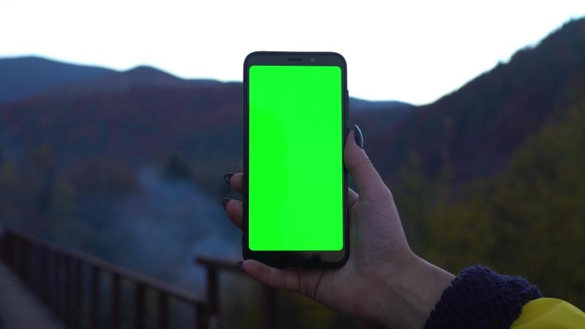 Smartphone in mountains green screen chromakey tracking matte vfx shot railway bridge technology technologies 4k | Shutterstock HD Video #1040706533