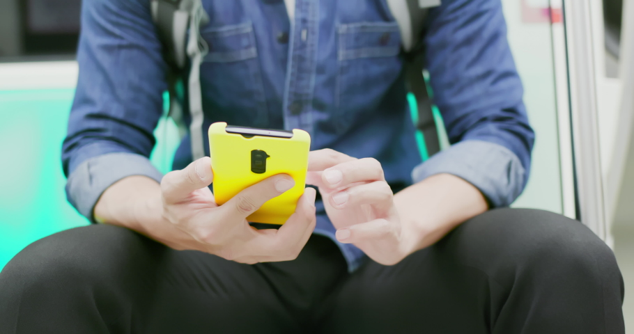 Close up of asian young man use 5g smartphone on the mrt or train | Shutterstock HD Video #1040827283
