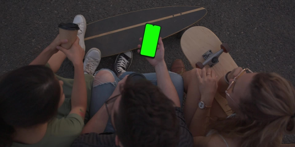 Green screen, CINEMATIC SHOT of friends hipsters millennials multinational girls young women and men sitting outside drinking coffee and chatting, talking. Slow motion   Shutterstock HD Video #1040880983