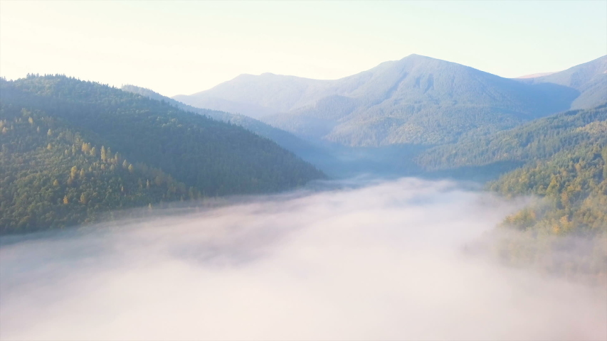Aerial mountain landscape. Beautiful   fly over clouds in valley, hills with wood.     #1041026573