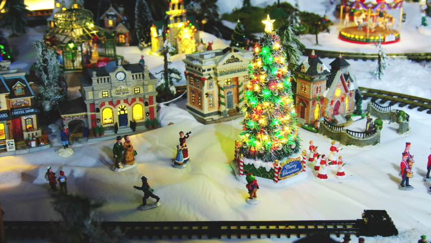 Miniature christmas tree town village with trains tram cable car wagon . | Shutterstock HD Video #1041092773