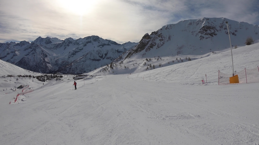 Ponte di Legno, Tonale, Italy. Skiing on the slopes in a wonderful day. POV from the skier. Point of view from the ski helmet. Italian Alps
