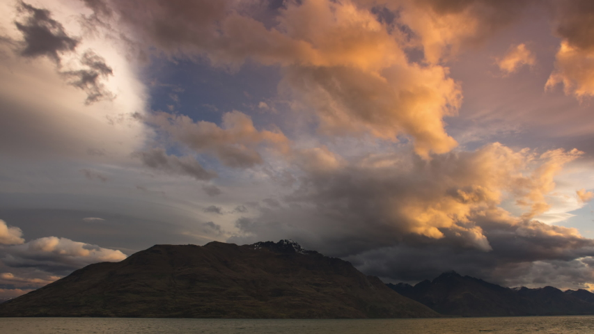 4k time lapse of Beautiful sunset over Lake Wakatipu in Queenstown, New Zealand.Camera tilt up. #1041334963