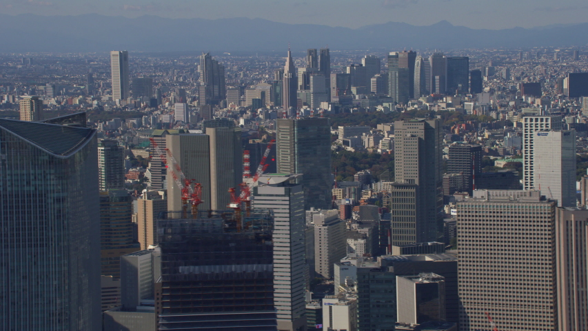 Tokyo, Japan circa-2018. Aerial view of Tokyo downtown buildings. Shot from helicopter with RED camera. | Shutterstock HD Video #1041367813