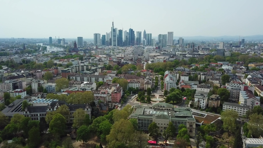 Aerial top view of the cityscape in Frankfurt, Germany. Drone flying over green trees and city buildings | Shutterstock HD Video #1041417043