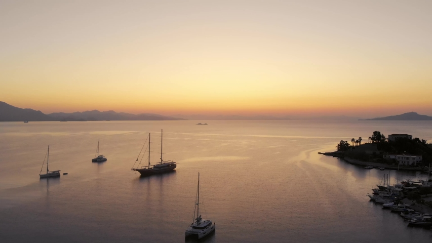 Anchored sailing ships in Datca harbor and a great sunrise. Aerial shots | Shutterstock HD Video #1041417433