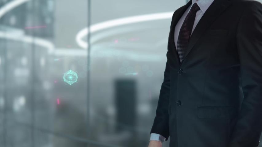 Businessman with HCM hologram concept   Shutterstock HD Video #1041458083