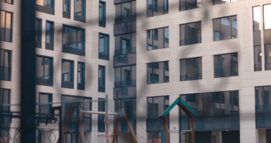 Courtyard with a playground in the area of apartment buildings   Shutterstock HD Video #1041560113