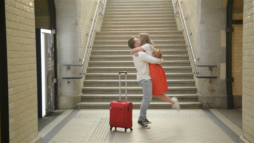 Young Couple Happy To Meet Again In The Train Station. Girl Runs To Meet Her Boyfriend. | Shutterstock HD Video #1041667693