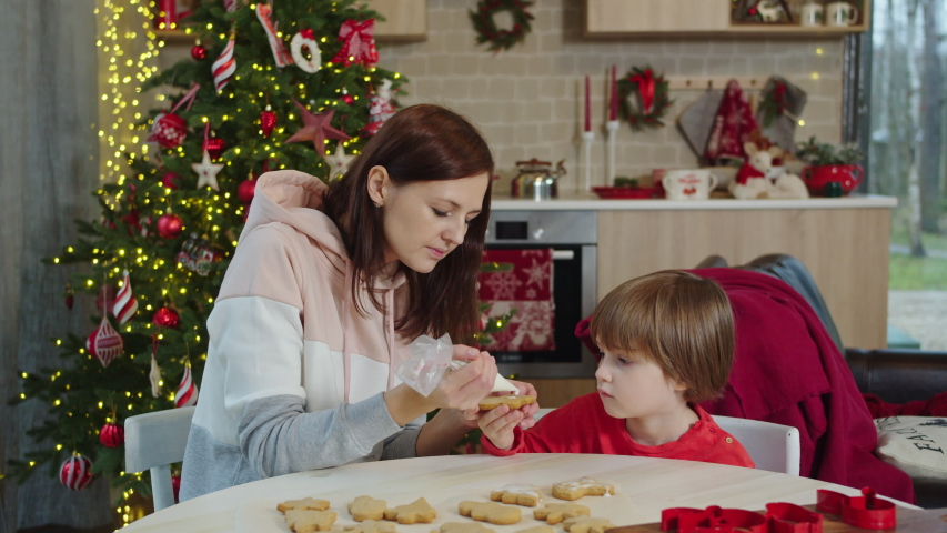Mom and son decorate christmas cookies | Shutterstock HD Video #1041783253