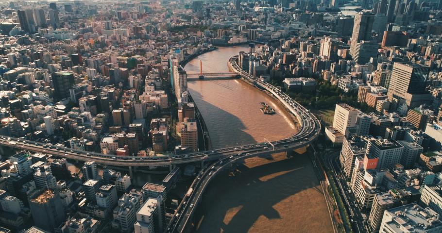 Aerial shot of busy metropolitan expressway No.7 in Tokyo city at dawn, Japan | Shutterstock HD Video #1041915043