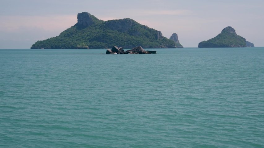 Group of Islands in ocean at Ang Thong National Marine Park near touristic Samui paradise tropical resort. Archipelago in the Gulf of Thailand. Idyllic turquoise sea natural background, copy space | Shutterstock HD Video #1042108033