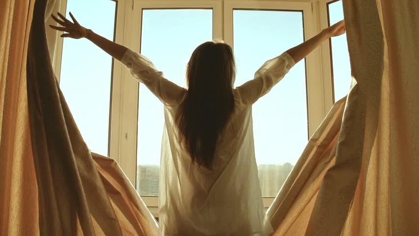 Woman in the morning. Attractive sexy woman with slender body opens curtains on big window and let the light in the room and has a perfect cozy morning. Slow motion #10421963