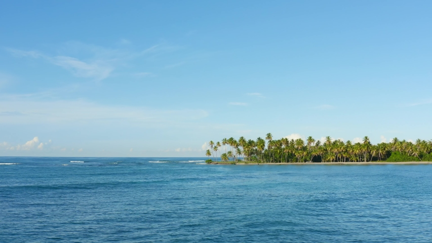 Palms Island in the ocean landscape. Tropical palm beach copy space. Nature paradise landscape. Island beach background. Blue sea and beach and sky. Dominican Republic Punta Cana