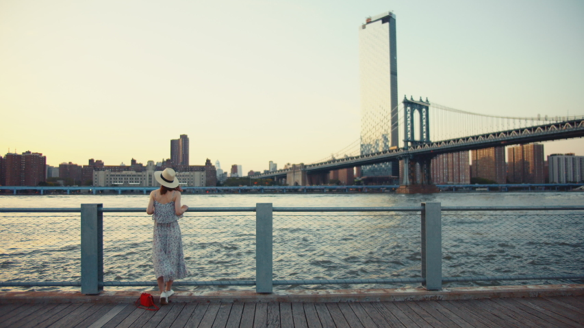 Young girl on the promenade in New York | Shutterstock HD Video #1042252453
