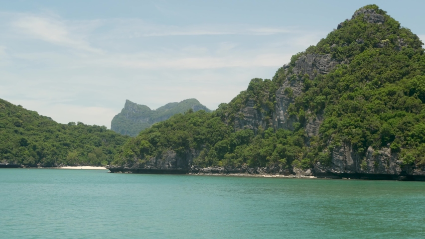 Group of Islands in ocean at Ang Thong National Marine Park near touristic Samui paradise tropical resort. Archipelago in the Gulf of Thailand. Idyllic turquoise sea natural background, copy space | Shutterstock HD Video #1042429213
