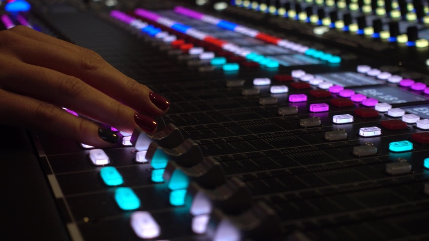 Professional recording studio. Close-up of a mixing console, the hand adjusts the faders. | Shutterstock HD Video #1042569523