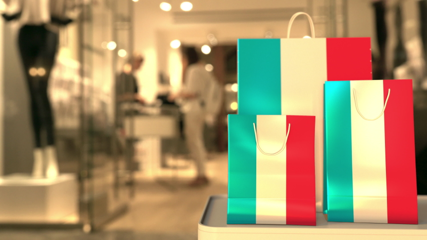 Flag of Luxembourg on the paper shopping bags against blurred store entrance. Retail related clip | Shutterstock HD Video #1042643563