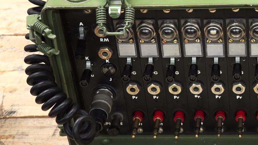 Military walkie-talkie. Means of communication.   Shutterstock HD Video #1042783753