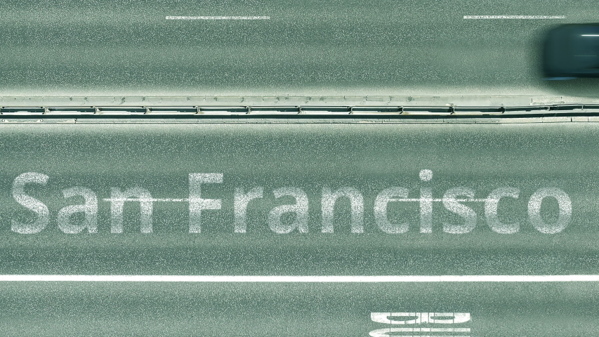 Aerial down view of the motorway with cars revealing San Francisco caption. Car travel to the United States intro clip | Shutterstock HD Video #1042787983