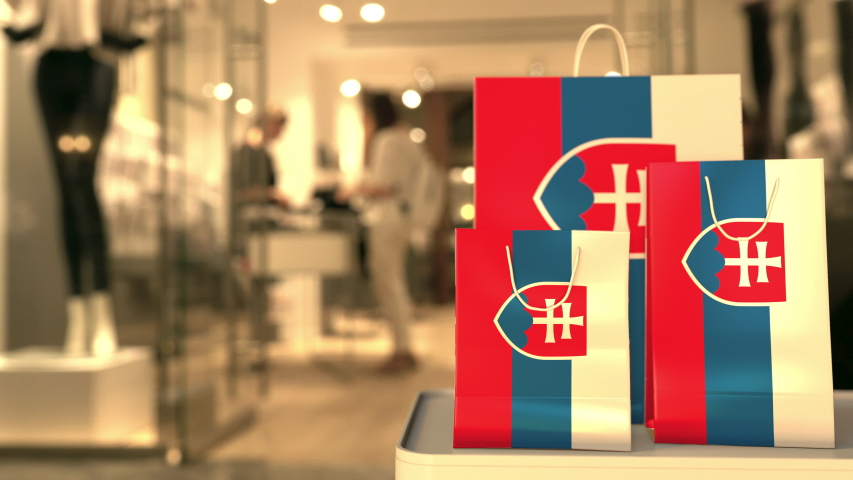 Flag of Slovakia on the paper shopping bags against blurred store entrance. Retail related clip | Shutterstock HD Video #1042820623