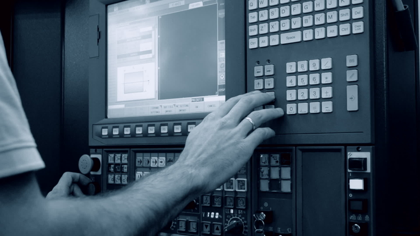 Person works behind the control panel of the production machine at the factory.Industrial machinery, production aggregation and equipment mechanical automaton. Heavy machinery   Shutterstock HD Video #1042859143